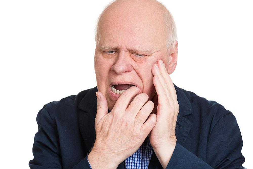Man with a painful gum abscess.