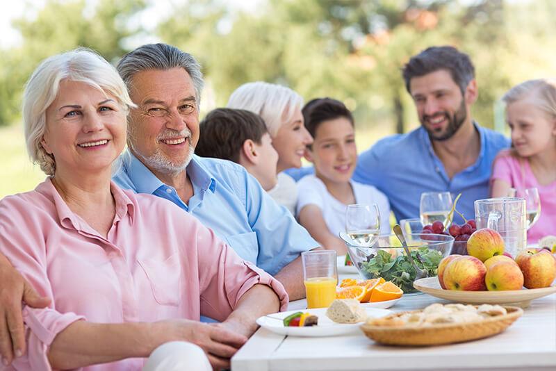 Multigenerational Family eating together outside